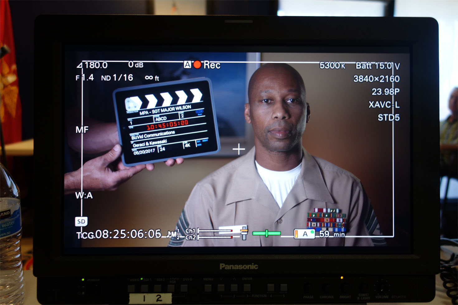 Movie slate, African-American Marine, video monitor