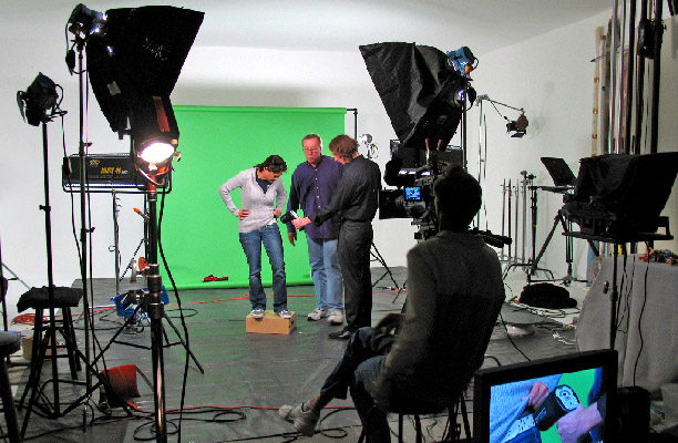 Video production crew working with green screen and cameras,